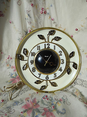 vintage retro United wall clock with metal gold leaf design electric