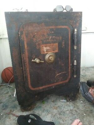 antique safe diebolt safe and lock 1800's. Everything works, cast iron, very old