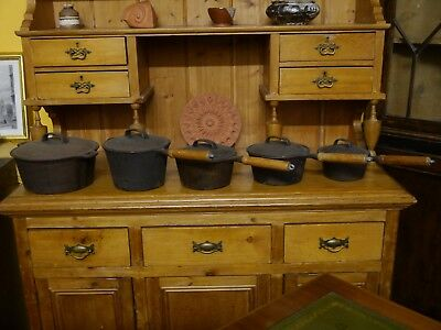 A Set Of 5 Vintage Iron Cooking Pots