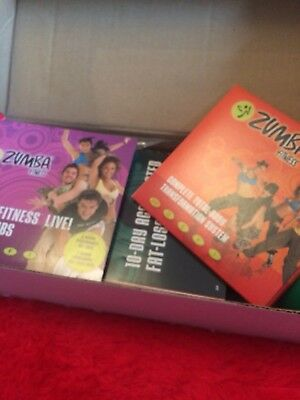 Zumba Fitness Complete Set With DVDs Book And Weights