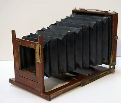 A half plate mahogany and brass folding camera,  double extending. Houghton?