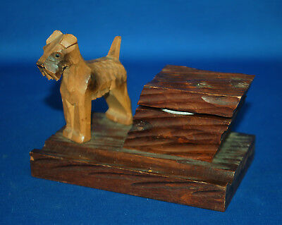 A well carved antique Victorian Airedale, Fox Terrier wooden inkwell, with liner