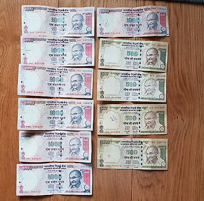 INDIA 7 x 1,000 and 4 x 500 Indian Rupee Banknotes.
