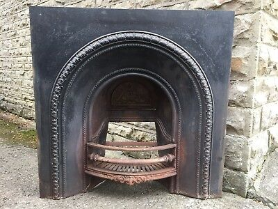 Cast iron fire surround including grate
