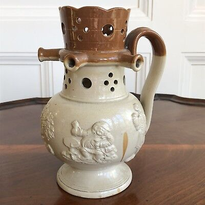 An Antique 19th Century Salt Glazed Stoneware Puzzle Jug. 19.5cm High.