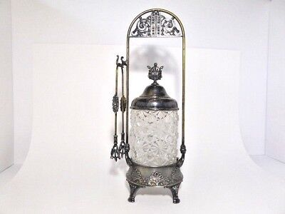 Simpson H. M.& Co. quadruple silverplate footed pickle castor with tongs