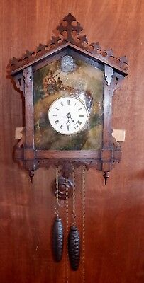 Black Forest Cuckoo Clock in Beha style with painted hunting scene.
