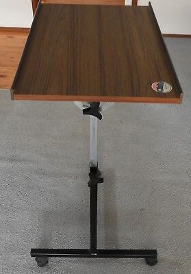 Over Chair height and angle adjustable table in great condition
