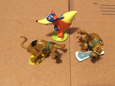 3 Scooby Doo Toy Figures and a Swiper