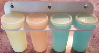 Tupperware Canisters with lids and wall rack, plastic, pastel, retro, vintage.