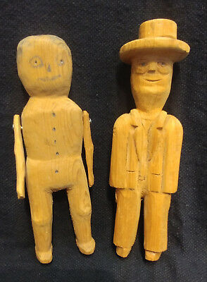 Old Hand Carved Folk Art Figures Of A Man And A Boy