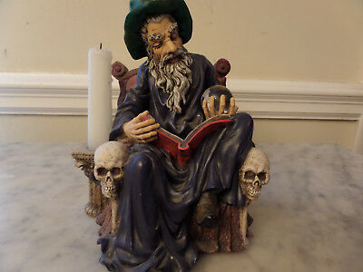 """Wizard Statue 1998 """"retired"""" Sitting in a chair with book and crystal ball"""