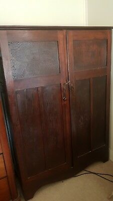 Antique vintage gentlemans cupboard dark wood good condition. Doors closed by to
