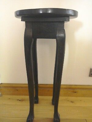 Antique 19th early 20th century occasional table with a rotating top.