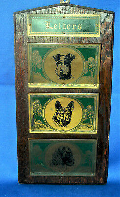 A decorative antique Edwardian brass & oak letter, newspaper rack, 3 dog breeds