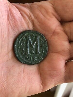 Byzantine bronze follis on large flan (34mm) of emperor Justinian, dated AD 549.
