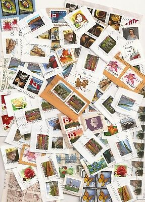 30g mix of small Canada stamps on paper