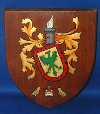 A very unusual medieval heraldic shield shaped hand painted wooden plaque