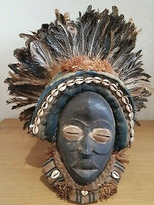 Fine African Dan Deangle wood mask with headdress. Ivory Coast.