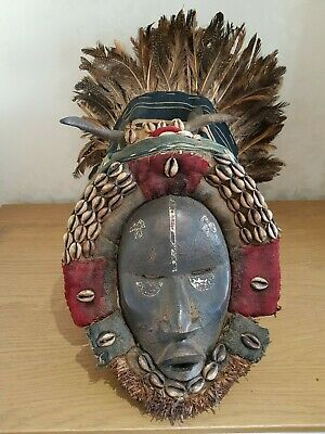 Huge and richly-crafted African Dan Deangle mask with headdress. Ivory Coast.