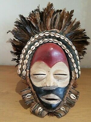 Colourful African Dan Deangle wood mask with headdress. Real animal horn.