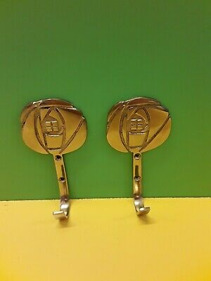 pair of large solid brass curtain tie back hooks Macintosh style