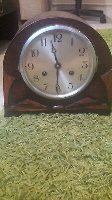 1930 s fhs mantel clock oak with sunbust design striking with chimes and key.