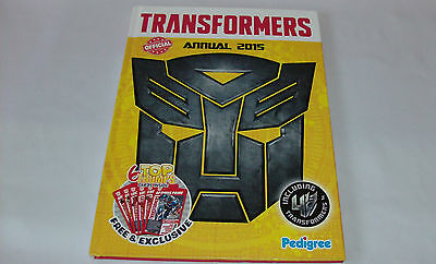 Transformers Official Annual 2015 with 6 top trumps attached. Used Book