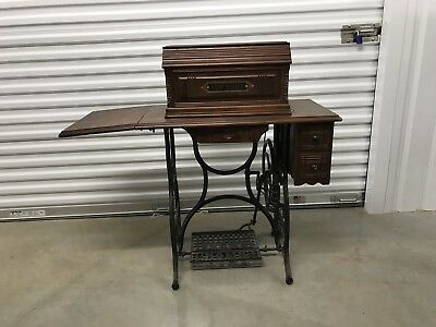 Antique 1889 NEW HOME Treadle Sewing Machine & Coffin Cover Wood Cabinet
