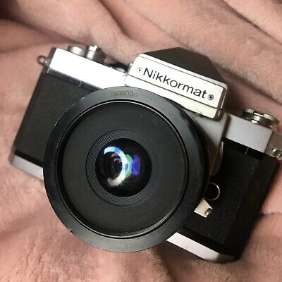 Nikkormat Camera With a Tamron 28mm Len See Pics