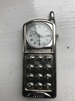 Miniature Silver Clock In Shape Of Mobile Phone