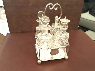 Vintage silver plated and glass 4 piece condiment set.