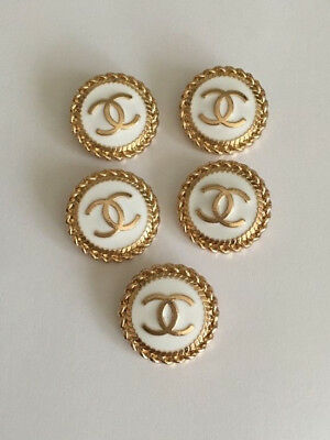 Chanel buttons in white and gold