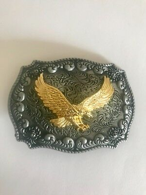 belt buckle gold eagle on pewter colour background with western flower design