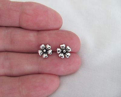 Sterling Silver 9mm Flower post stud earrings.