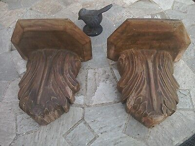 Antique beautifuly hand carved wooden corbels.