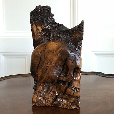 A 17th Century Style Hand Carved Burr Wood Memento Mori Skull. 24cm High.