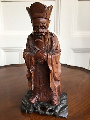 A Chinese Carved Wood Figure Of An Old Sage, Qing, 19th Or Early 20th Century.