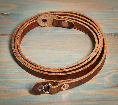 46in Hand made leather camera strap. Chestnut with copper rivets.