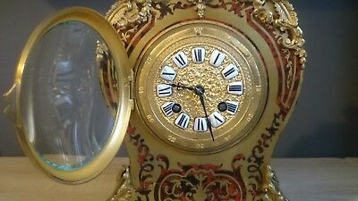 Antique French red Boulle clock