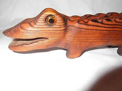 Cool hand carved wood alligator with glass eyes, folk art