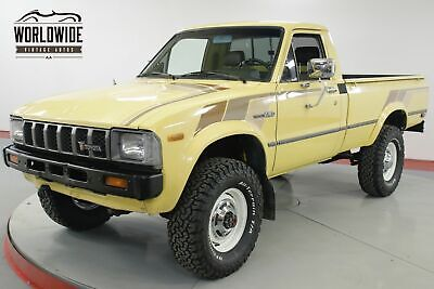 1982 TOYOTA PICKUP HILUX STRAIGHT AXLE 4x4 RARE LOW MILES 5 SPD CALL 1-877-422-2940! FINANCING! WORLD WIDE SHIPPING. CONSIGNMENT. TRADES. FORD