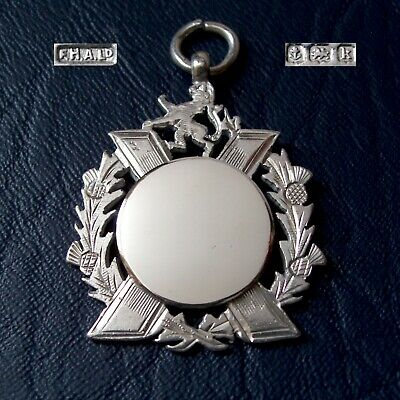 Antique Scottish design solid silver fob medal for a watch chain / pendant. 1909