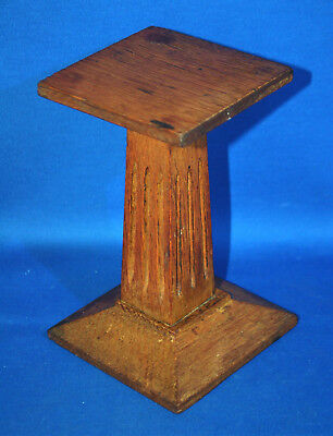 A characterful antique wooden shop, display stand, shoe stand, hat stand