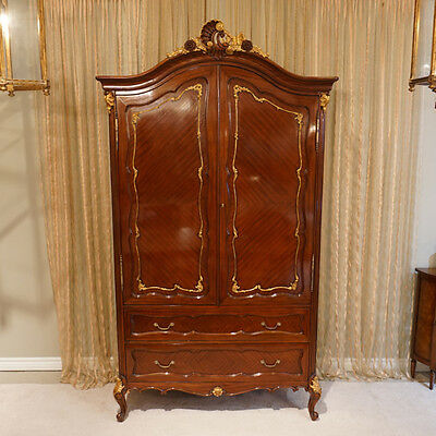 Large Mahogany double door Armoire with Inlay hand carved with Gold Leaf Accents