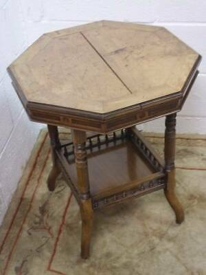 VICTORIAN WALNUT OCTAGONAL TABLE, UNDER TIER with DECORATIVE SUPPORTS ON CASTERS