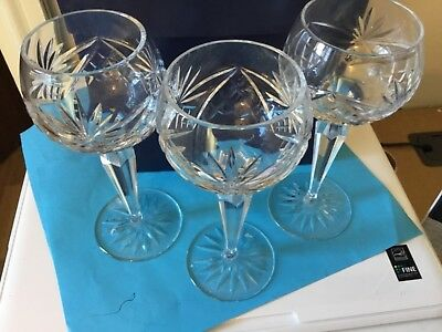 Three cut glass crystal hock glasses, from the Sussex goldsmiths. be Waterford