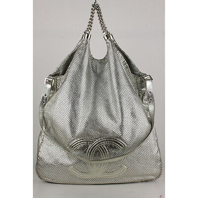 94f2b9f70fed Authentic Chanel Silver Perforated Leather Large Rodeo Drive Hobo Bag
