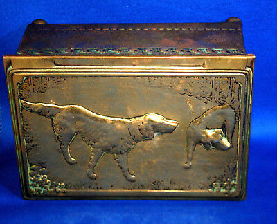 An unusual Victorian brass sporting dog repousse work box or casket, wood lined