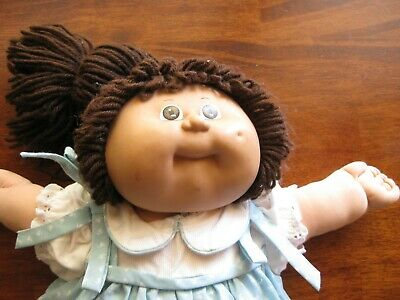 original cabbage patch doll and clothes  is in great condition brown pony tail
